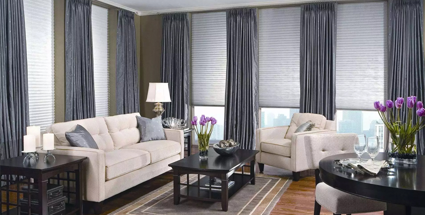 Combination of window blinds and drapes
